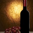 Wine List Design Series: Bottle of red wine and grapes with copy — Stock Photo #19415389