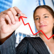 Business woman drawing a graph in the city — Stock Photo