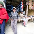 Young boys from Ecuador Andes at selling their handcrafts - Stock Photo