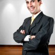 Elegant, young and smiling business man at office — Stock Photo