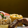 Ecuadorian food series: pork rib with corn salad - Stock Photo