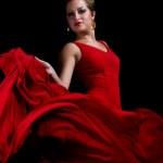 Portrait of beautiful young woman dancing flamenco studio shot — Stock Photo #19417695