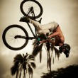 Young man flying on his bike: Dirt jump — Stock Photo #19417741