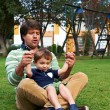 Happy Father and son playing at the park — Stock Photo