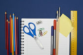 Back to School Series: shool supplies on blue background — Stock Photo