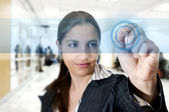 Busines woman at airport touching digital screen — Stock Photo