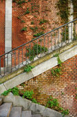Brick wall and stairs background — Stock Photo