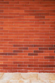 Reb brick wall and tile floor — Stock Photo