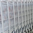 Cart at supermarket closeup — Stock Photo