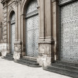 Antique architecture: Medieval european church's door — Stock Photo