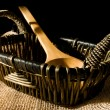 Still life: basket and wooden spoons — Stock Photo
