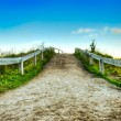 Stock Photo: Dirt road and clear skies HDR