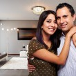 Young happy couple at their new modern house - Foto Stock