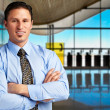 Young successful businessman at airport — Stock Photo