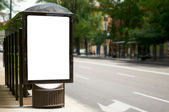Empty white billboard at bus stop — ストック写真