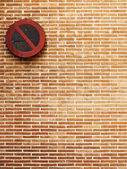 Brick wall background with no parking sign — Stock Photo