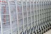 Cart at supermarket closeup — Stock Photo