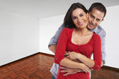 Young happy couple at their new house — Stock Photo