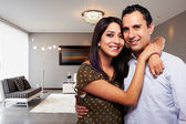 Young happy couple at their new modern house — Stock Photo
