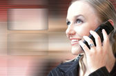 Woman on the phone high tech — Stock Photo