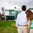 Young couple watching new big house — Stock Photo