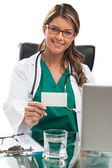 Smiling medical woman doctor at private practice showing busines — Stock Photo