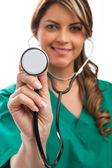 Smiling medical woman doctor with stethoscope. Isolated over whi — Stock Photo