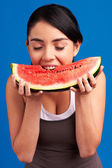 Health Concept: Young healthy slim woman biting fresh watermelon — Stockfoto