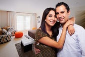Young happy couple at bedroom — Stock Photo