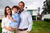 Happy Family at new big house — Stock Photo