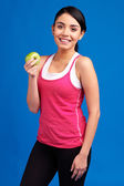 Health Concept: Young healthy slim woman holding green apple ove — Stock Photo
