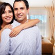 Young happy couple at their new house — Stock Photo #25971359