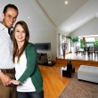 Stock Photo: Young happy couple at their new house