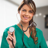 Smiling medical woman doctor with stethoscope. — Foto de Stock
