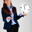 Business woman holding clock - Stock Photo