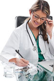 Woman doctor at desk with laptop — Stock Photo