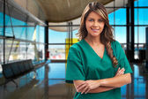 Smiling medical woman doctor at hospital — Stock Photo