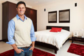 Young succesful casual man at bedroom — Stock Photo