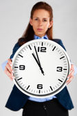 Time Concept: Business woman holding clock — Stock Photo
