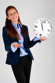Business woman holding clock — Stock Photo