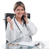 Woman doctor at desk — Stock Photo