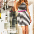 Young casual woman shopping at the mall — Stock Photo
