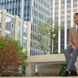 Stock Photo: Young successful black business man in the city
