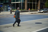 Business man walking in the city — Stock Photo