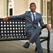 Young relaxed successful African - American business man in the — Stock Photo