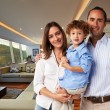 Young happy family at home: Mother, father and son — Stock Photo