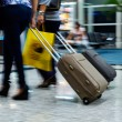 People walking at airport (motion blur) — Stock Photo