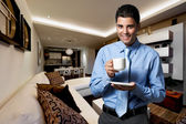 Young successful business man at home — Stock Photo