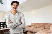 Happy casual young man at modern apartment — Stock Photo