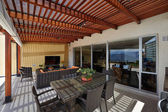 Interior design: Beautiful modern terrace lounge with pergola — Stock Photo